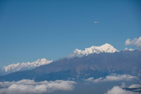 Nepal Airlines flying with the beautiful Himalaya Mountain Range in the background.