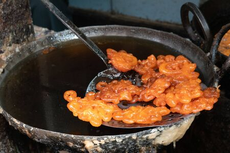 Some fresh jalebi sweet snacks right out of the frying pan. Stok Fotoğraf