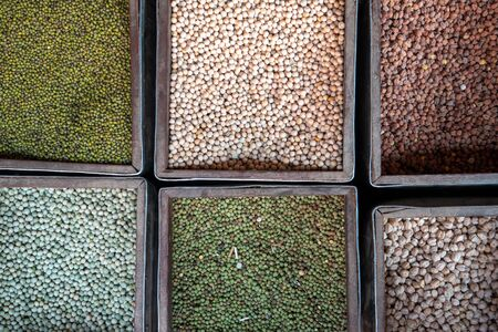 Six bins of different kinds of bean for sale at a local market. Stok Fotoğraf