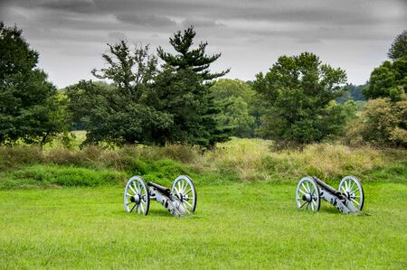 Two cannons in a field at Gettysburg National Battlefield.