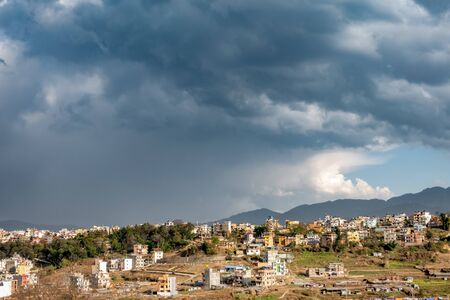 The black clouds of a thunderstorm over the city of Kathmandu, Nepal.