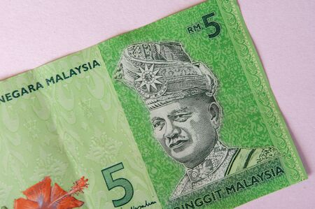 A five RM paper currency note from Malaysia.