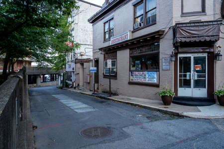 Harrisburg, Pennsylvania - July 18, 2020: Some bars in a back alley in Harrisburg, Pennsylvania.