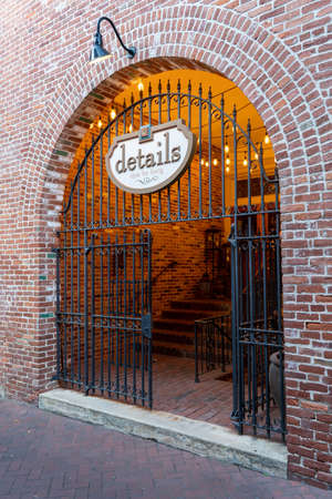 Lancaster, Pennsylvania - July 11, 2020: An iron gated entrance in a brick wall leading to a store. Imagens