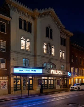 Lancaster, Pennsylvania - july 11, 2020: The Fulton theatre lit up with lights in the night in Lancaster City.
