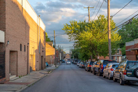 Lancaster, Pennsylvania - July 11, 2020: A city street lined with parked cars in the evening.