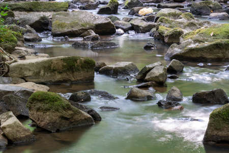 A long exporsure of a creek causing the water to blur to a silky smooth. Imagens