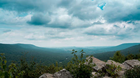A time-lapse of storm clouds moving over the tree covered hills of the Appalachian Mountain Range.