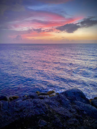 A beautiful sunset over the waves of the sea.