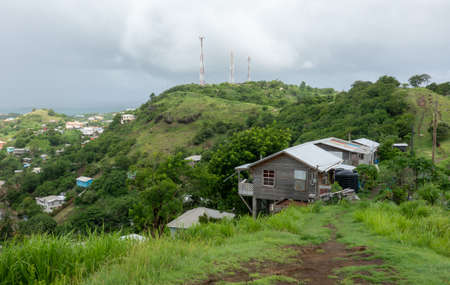 A house perched on the side of a hill in Grenada.