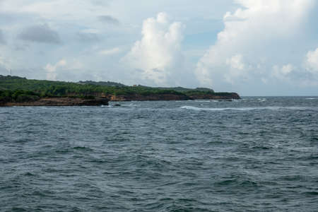 The jagged rocky coastline of a small island.