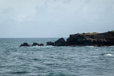 A rocky peninsula jutting out into the sea. 免版税图像
