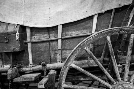 An abstract photo of a wheel and wagon box of an old covered wagon. 免版税图像