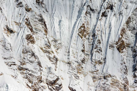 The beauty of the snow white cliffs on the mountainside.