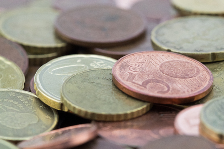 Macro of euro cents coins. Coins of fifty euro cents, twenty euro cents and five euro cents. Savings.