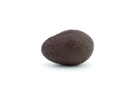 Avocado or alligator pear on white background. The avocado has many nutrients, it's often referred to as a superfood. Imagens