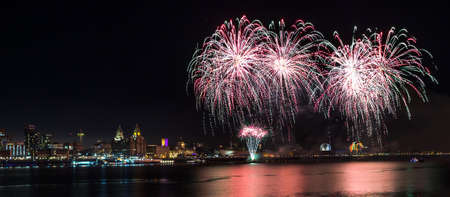 Lighting up the sky with fireworks high above the city of Liverpool. Stock Photo