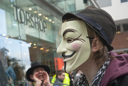 guy fawkes mask: An Occupy Exeter activist wearing a Guy Fawkes mask outside the Exeter branche of Topshop Editorial