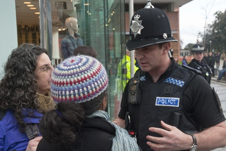 Devon & Corwall police officers confonts two Occupy Exeter activists during their direct action outside the Exeter branch of Topshop