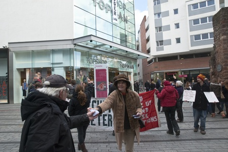 guy fawkes mask: Occupy Exeter activists campaign outside Exeter branches of Topshop Editorial