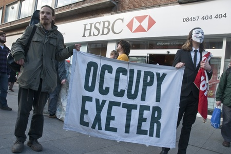 guy fawkes mask: Occupy Exeter activists campaign outside Exeter branche of HSBC bank