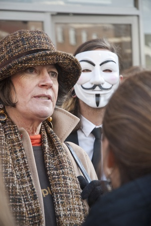 guy fawkes mask: Occupy Exeter activists gather outside Exeter branch of Vodafone
