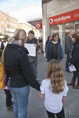 Occupy Exeter activists campaign directly with the public outside the Exeter branch of Vodafone