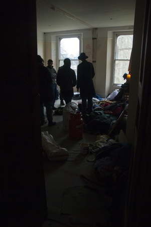 ows: Occupy Exeter activists gather in the guard room of Occupy Exeter site 2. Editorial