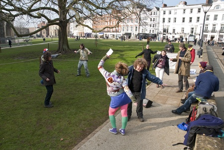 occ: Exeter Occupy activists dance on Exeter Cathedral Green during their official leaving event from their occupy camp.
