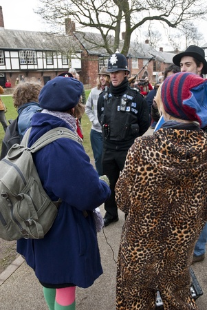 A Devon & Corwall policeman tells Occupy Exeter activists to remove cards thet were tied to the temporary fencing during Occupy Exeter Editorial
