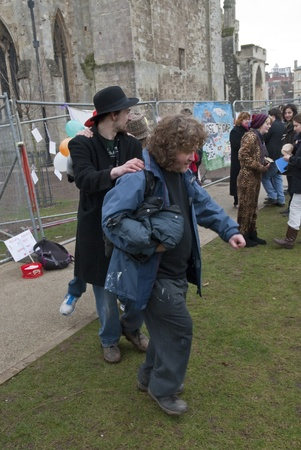 occ: Occupy Exeter activist take part in a conga during the Occupy Exeter leaving the Exeter Cathedral Green event in Exeter.
