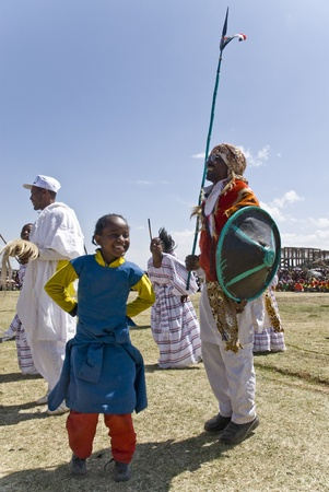 Ethiopian girl dancing with a tradition Ethiopian tribal man at the 2008 World Aids day in Fiche, Ethiopia