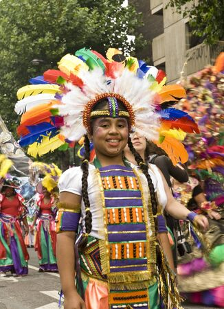 headress: Notting Hill, London-August 30: Member from the Sunshine International float at Notting Hill Carnival, August 30th 2009 in Notting Hill, London Editorial