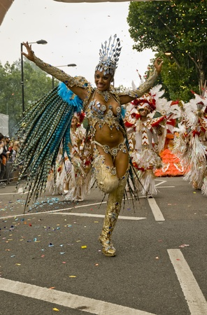 headress: Beautiful woman in a colourful costume with wings at the Notting Hill Carnival, as part of the the Paraiso School of Samba procession.