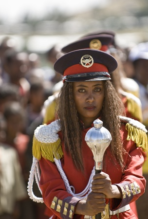 Female baton bearer from the Ethiopian Ceremonial Marching band standing on ceremony at the 20th World Aids Day Event in Fitche,  Ethiopia. Stock Photo - 12559366