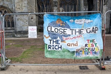 occ: A banner saying Close the Gap on the Rich tied to the  temporary fencing surrounding the area that was used by Exeter Occupy activists to have their camp. Editorial