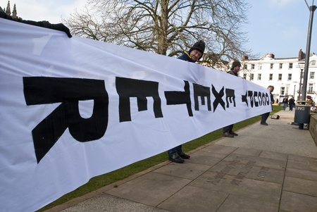 ows: The huge Occupy Exeter banner is unfurled and displayed in front of Exeter Cathedral during Occupy Exeter