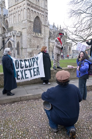 occ: Occupy Exeter celebrate their achievements as they leave their camp on Exeter Cathedral Green following eviction orders imposed by the Exeter Cathedral Chapter.  Exeter, UK. 11022012 Editorial