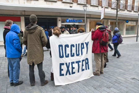 occ: Occupy Exeter activist take part in a  general assembly meeting outside the Exeter branch of Barclays Bank. Editorial
