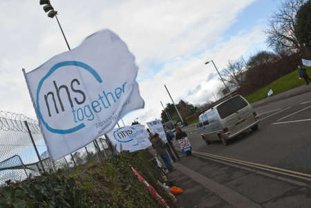 outcry: An NHS Together flag flaps in the wind on Barrack Road in Exeter, during the NHS reform protest outside the Royal Devon & Exeter Hospital.