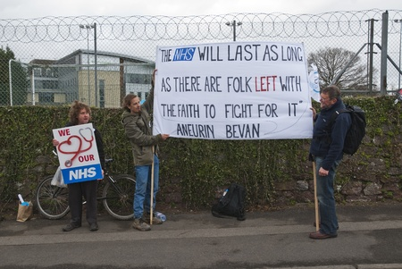 outcry: Protestors hold up a sign that has a quote from Aneurin Bevan, who spearheaded the establishment NHS, during the NHS reform protest outside the Royal Devon & Exeter Hospital.