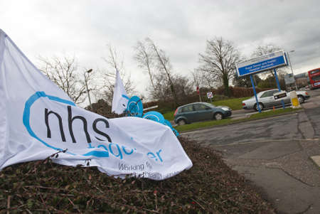 nhs: An NHS Together flag flaps in the wind on Barrack Road in Exeter, during the NHS reform protest outside the Royal Devon & Exeter Hospital.