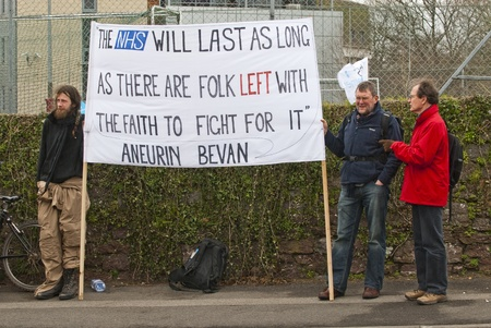 hold up: Protestors hold up a sign that has a quote from Aneurin Bevan, who spearheaded the establishment NHS, during the NHS reform protest outside the Royal Devon & Exeter Hospital.