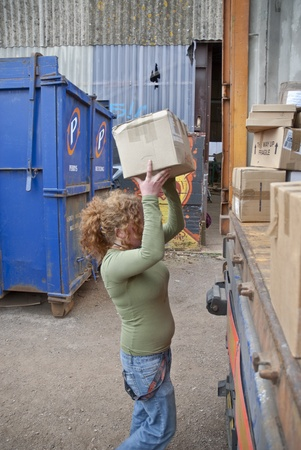 ghana: Volunteer from BookCycle loads the last box of books into the container that is taking donated book to Ghana Editorial