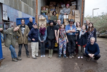 Member of the Exeter based organisation BookCycle stand by thier loaded container before it leave for Ghana.