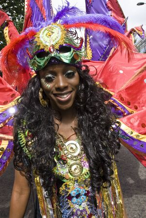 notting: Performer from the Sunshine International float at the Notting Hill Carnival August 30th 2010 in Notting Hill, London.