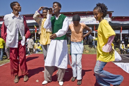 Ethiopian youth singing and dancing on stage at the 20th World Aids day Event in Fitche, Ethiopia