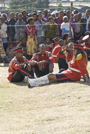 Members of the Ceremonial Marching band Relax before the start 20th World Aids Day Event in Fitche, Ethiopia