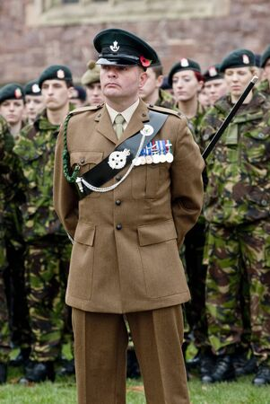 Soldiers stand to atention during the rememberance Day service at Exeter Cathedral on Exeter Cathedral Green.