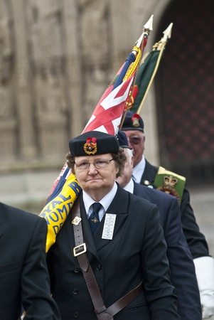 Flag barers from the Royal British Legion march with their flags from Exeter Cathedral during the rememberance Day service at Exeter Cathedral on Exeter Cathedral Green. Sajtókép
